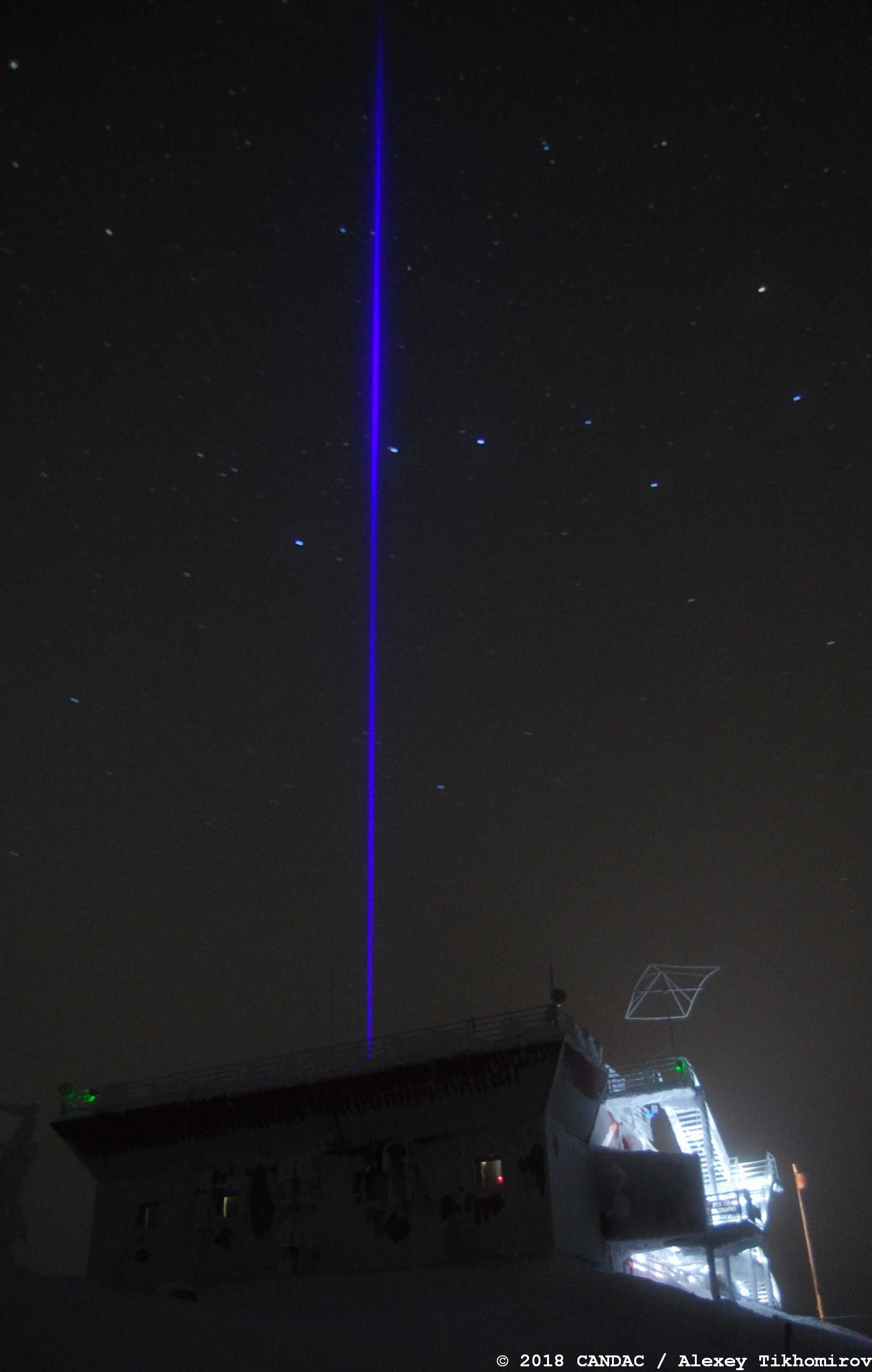 SOLID in operation on November 5, 2018. The laser beam is passing through a thin cloud over the PEARL Ridgelab.